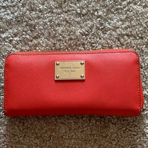 Red leather Michael Kors bifold wallet